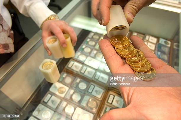 bz14gold_bb_1 Krugerrand gold bullion coins being counted at Rocky Mountain Coin Inc 538 S Broadway where business has been booming as the price of...