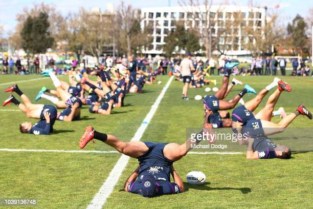 c of the Storm stretches with teammates during a Melbourne Storm NRL training session at Gosch's Paddock on September 24 2018 in Melbourne Australia
