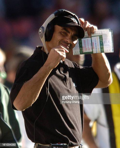 DENVER C0___Jets Head Coach Herm Edwards is not too pleased with his teams play in the first ahlf of the game the game between the Denver Broncos and...
