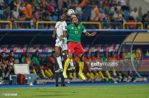 !c13! and Wakaso Mubarak of Ghana challenging for the ball during the 2019 African Cup of Nations match between Cameroon and Ghana at the Ismailia...