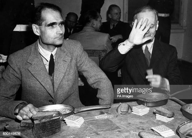 Former Deputy Fuhrer Rudolf Hess and former German Foreign Minister Joachim von Ribbentrop eating a meal under guard at the Nuremberg Court House...