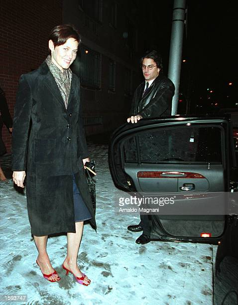 Actress and former Ford model Cary Lowell gets into a waiting limosine after her 40th birthday party celebration in the early hours of February 13...