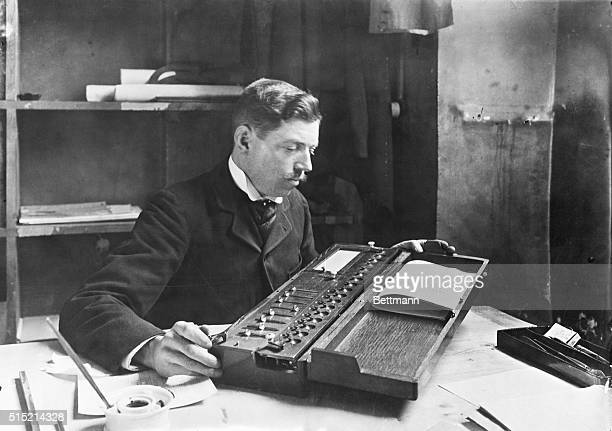 Ca 1895Photograph of a calculating machine invented by M Thomas DeColmar in ca 1820 A man is shown using the machine