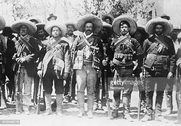Ca. 1909-1920-Pancho Villa , Mexican bandit and revolutionary leader, lined up with some of his followers.