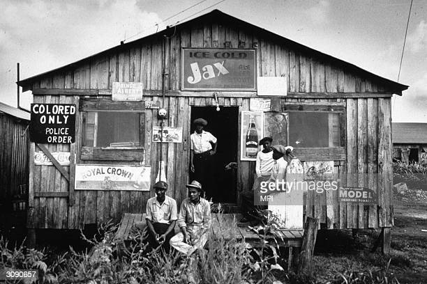Ca. 1941: Segregated store for migrant workers in Belle Glade, Florida, 1941. Police-order segregation was designed to assure only African-Americans...
