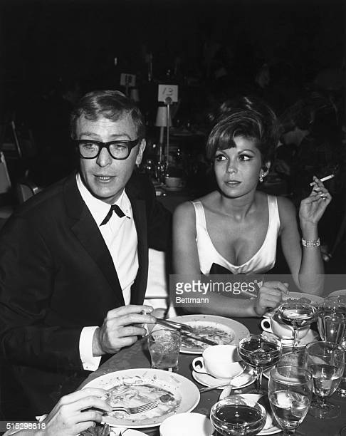The newest combination in town is Nancy Sinatra and British actor Michael Caine Doesn't he look impressive and vedy vedy British Nancy seems...