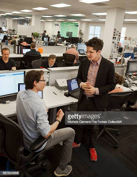 Aaron Levie, in de rigueur neon trainers, chats up cofounder Dylan Smith at Box's Silicon Valley headquarters.