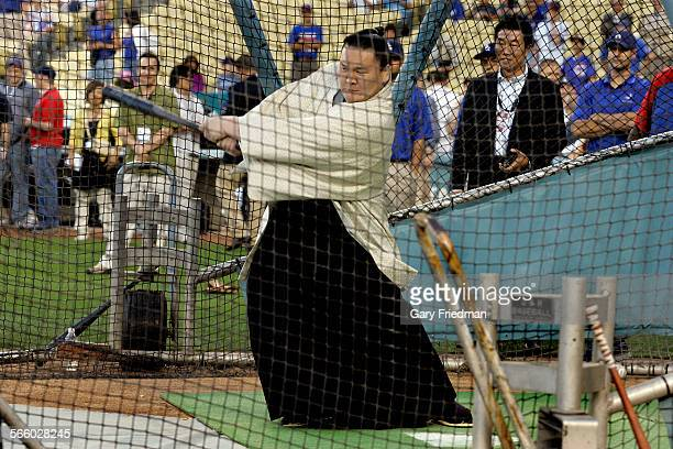 Ca. June 6, 2008 Hakuho, one of the top sumo wrestlers in the world, takes in some batting practice at Dodger Stadium on June 6, 2008 before the...