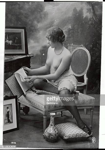 Ca1890'sFrance French postcard showing girl in half undress
