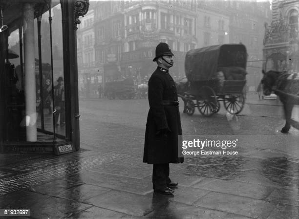 ca1900s An English policeman stands on the corner of an unidentified street in the West End of London London UK