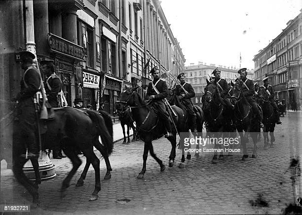 ca1910 A group of Russian Cossacks on horseback riding through a city street Russia