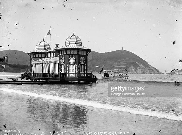 ca1910 The portable beach house of King Alphonse XIII of Spain is being placed into position on the beach ca San Sebastian Spain