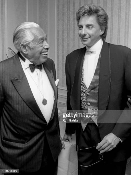 Cab Calloway and Barry Manilow attend 22nd Annual Songwriters Hall of Fame Induction Dinner on May 29 1991 at the New York Hilton Hotel in New York...