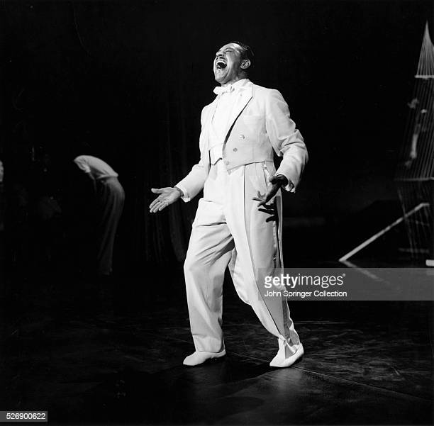 Cab Calloway singing in a white tuxedo