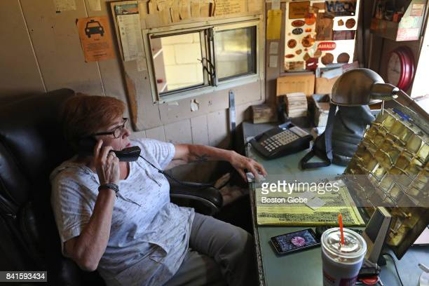 Cab dispatcher Kathi Peters talks on the phone at the Newton Yellow Cab company in Newton MA on Aug 30 2017 She has worked in the cab industry since...