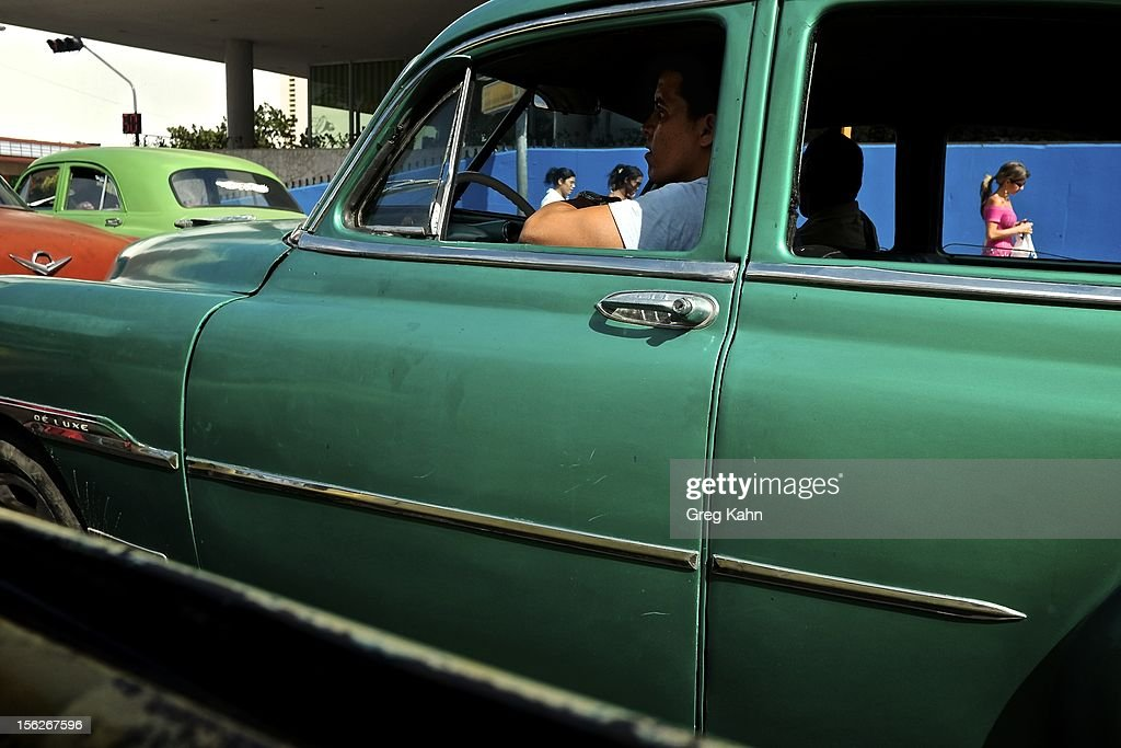 A cab driver passes through Old Havana on November 12, 2012 in Havana, Cuba. New business regulations in the communist country have allowed thousands of citizens to make money for themselves for the first time since 1959.