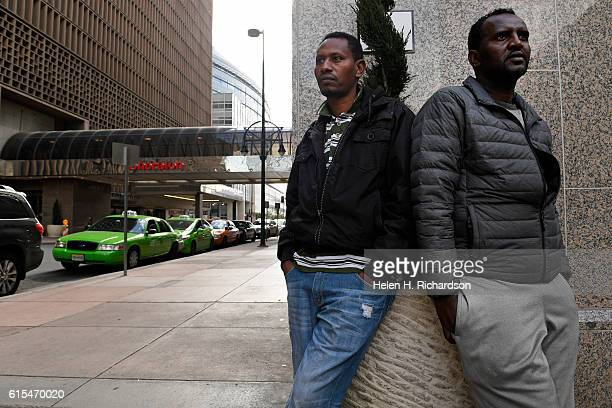 Cab drivers Abubaker Abadidu middle and Eseyas Weldye right wait sometimes long hours trying to get passengers for their taxis outside of the...