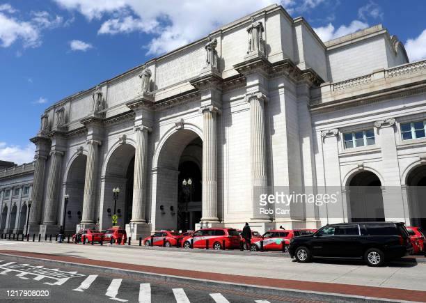 Cab drivers wait for fares outside of Union Station on April 09, 2020 in Washington, D.C. Amtrak and commuter trains have cut daily routes amid the...