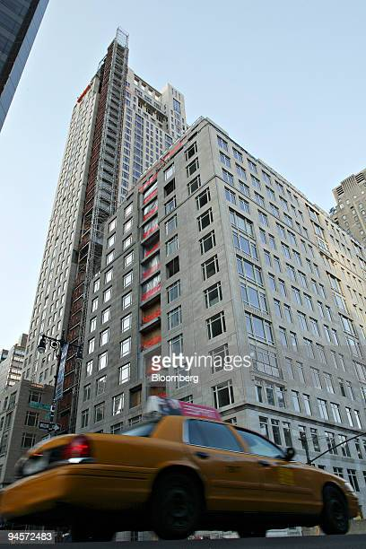 A cab passes 15 Central Park West during its renovation in New York US on Monday Nov 5 2007