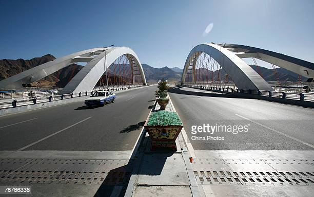 A cab runs on the Lhasa River Bridge which connects downtown Lhasa and railway station on January 5 2008 in Lhasa of Tibet Autonomous Region China...