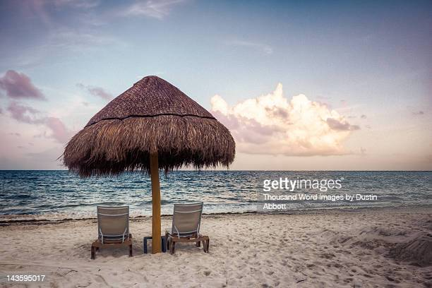 cabana hut by sea at sunset - dustin abbott stock pictures, royalty-free photos & images
