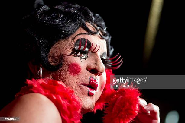 A cabaret artist portraying the cartoon character Betty Boop performs on the stage of the Michou cabaret in Paris on December 23 2011 AFP PHOTO /...