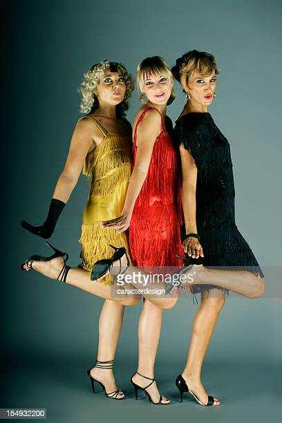 cabaret dancing girls - burlesque stock pictures, royalty-free photos & images