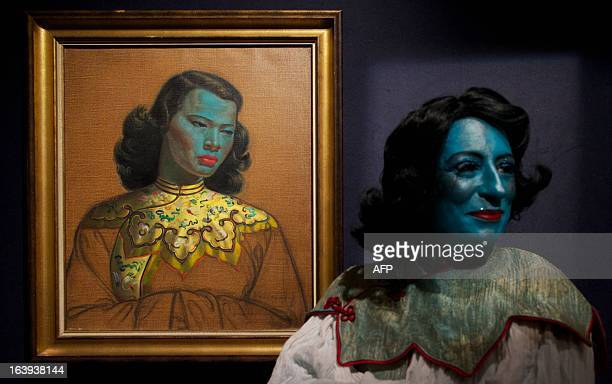 Cabaret singer Tricity Vogue dressed as the blue lady a character inspired by the painting 'Chinese Girl' by artist Vladimir Tretchikoff poses by the...