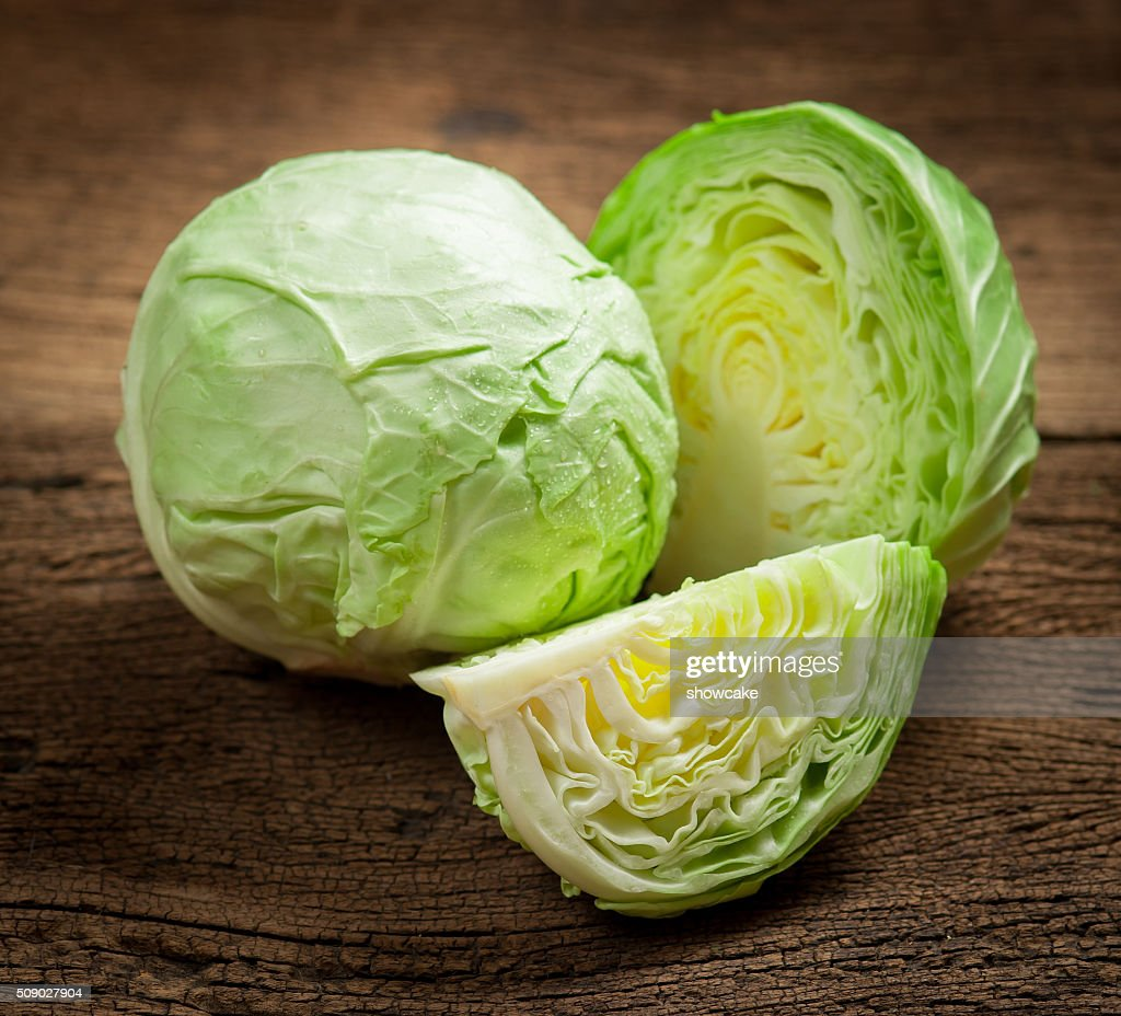 cabbage and cutted cabbage on wooden : Stock Photo