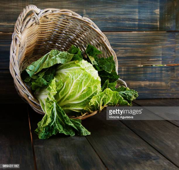 cabbage in a basket, rustic - brassica rapa stock photos and pictures