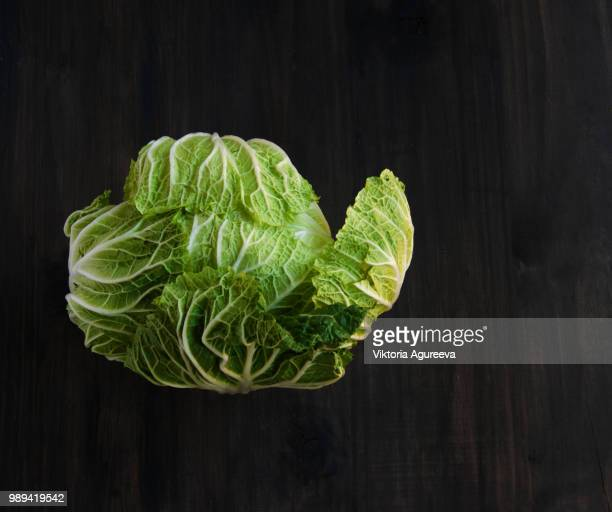 cabbage on a black wooden boards
