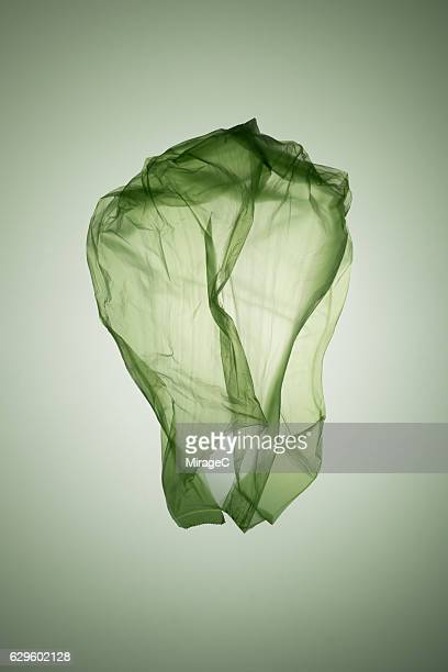 cabbage shape green plastic bag - food contamination stock photos and pictures