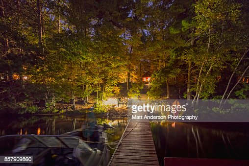 Cabin and boat dock at night on DAM lake WI