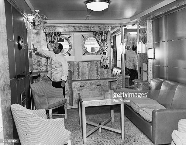 Cabin class private lounge of the Cunard White Star liner RMS Mauretania receives a final polish, days before the vessel's maiden voyage from...