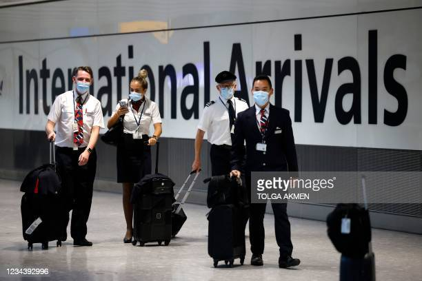 Cabin crew arrive at Heathrow's Terminal 5 in west London on August 2, 2021 as quarantine restrictions ease. - People fully vaccinated in the United...