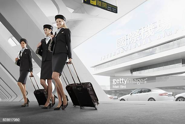 Cabin crew arriving at airport terminal building