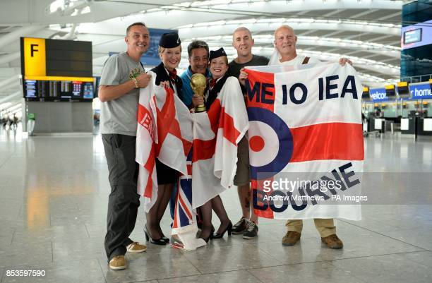 BA Cabin Crew Kimberley Lauf and Jane Lynch pose with England fans in departures at Terminal 5 at Heathrow before they head off to the World Cup in...