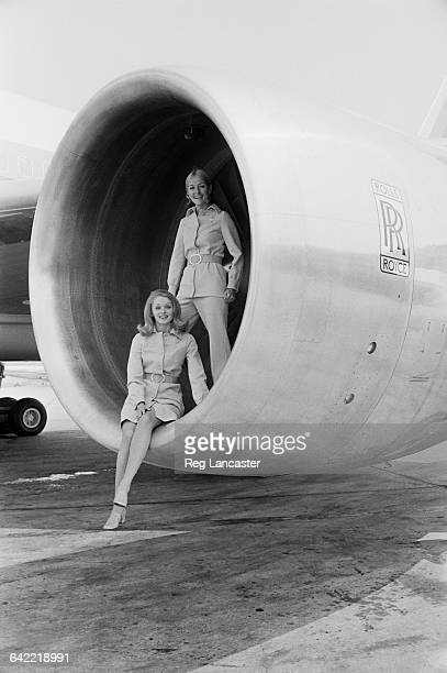 Cabin crew Marilyn Spillane and Rebecca Armstrong pose in the Rolls-Royce engine of a Lockheed L-1011 TriStar airliner at the Paris Air Show, France,...