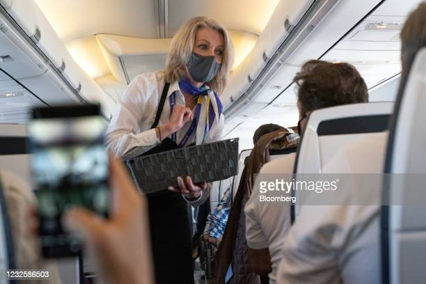 Cabin crew member distributes refreshments during an in-flight service on the Avelo Airlines inaugural flight from Hollywood Burbank Airport in...