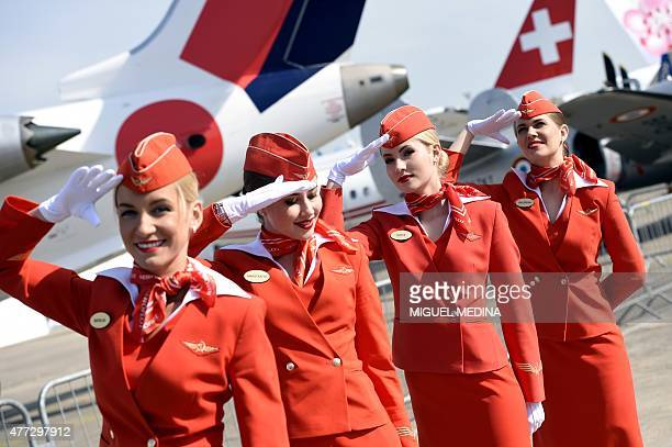 Cabin crew of the Russian airline Aeroflot salte as they walk past during the International Paris Airshow at Le Bourget on June 16 2015 AFP PHOTO...