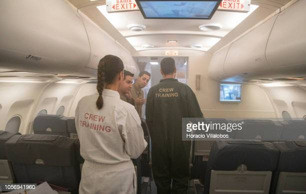 TAP cabin crew seen inside a smoke filled mockup A320 fuselage during a practice of abandoning a plane on fire at TAP Air Portugal training center in...