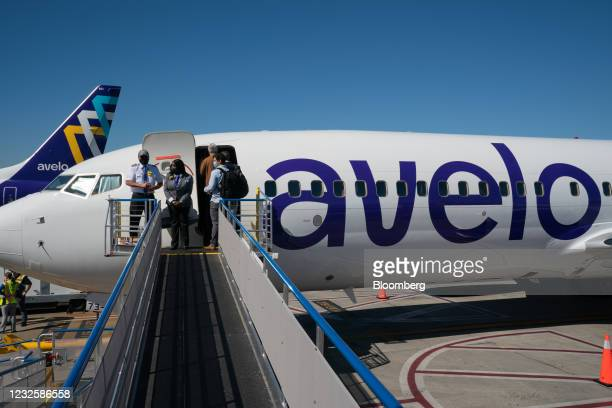 Cabin crew wait as passengers board a Boeing Co. 737-800 aircraft operated by Avelo Airlines ahead of the airline's inaugural flight at Hollywood...