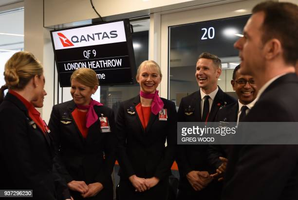 Cabin crew wait to board a Qantas 787 Dreamliner before taking off on its inaugural flight from Perth to London on March 24 2018 Qantas' 14498...