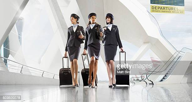 Cabin crew walking through large modern airport building