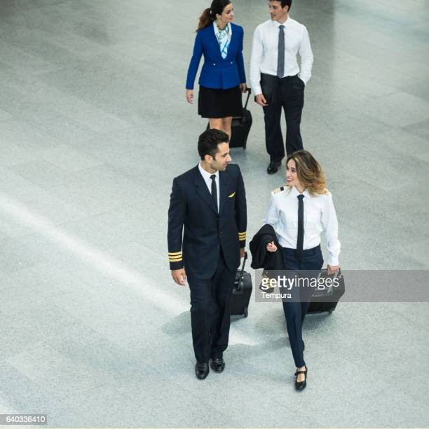 Cabin crew walking through the airport.
