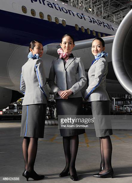 Cabin crews of All Nippon Airways pose for photographs during their new unform unveiling at a hangar in Tokyo International Airport on April 24 2014...