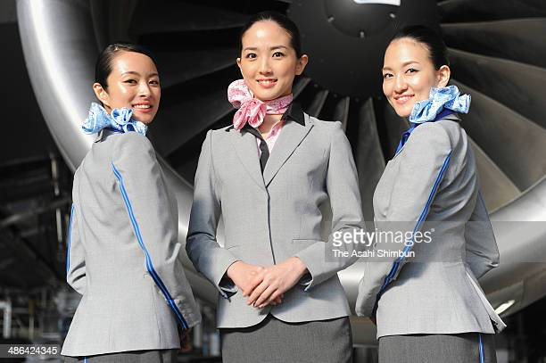 Cabin crews of All Nippon Airways pose for photographs during their new uniform unveiling at a hangar in Tokyo International Airport on April 24 2014...