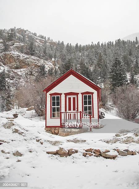 Cabin on side of mountain, winter