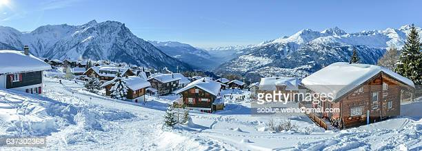 Cabin Retreat - Brief Cabins village in Snow on the Swiss alps with Valais alps mountain range view