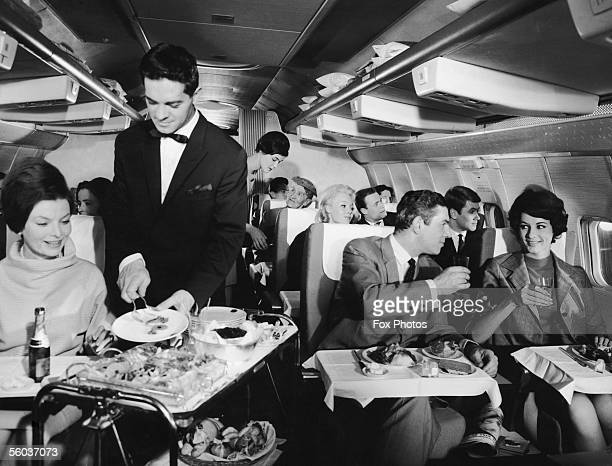 Cabin service on board an intercontinental Boeing 707 during a flight with the West German airline Lufthansa 26th April 1967